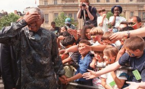 Nelson Mandela laughing with children...